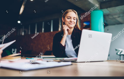stock-photo-successful-female-grapic-designer-watching-tutorial-about-creative-ideas-at-laptop-computer-during-1033103851